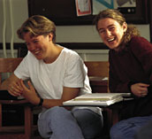two students share a laugh