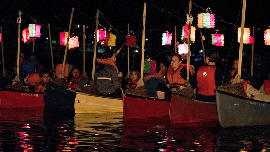 Photo of students in canoes for the canoe sing