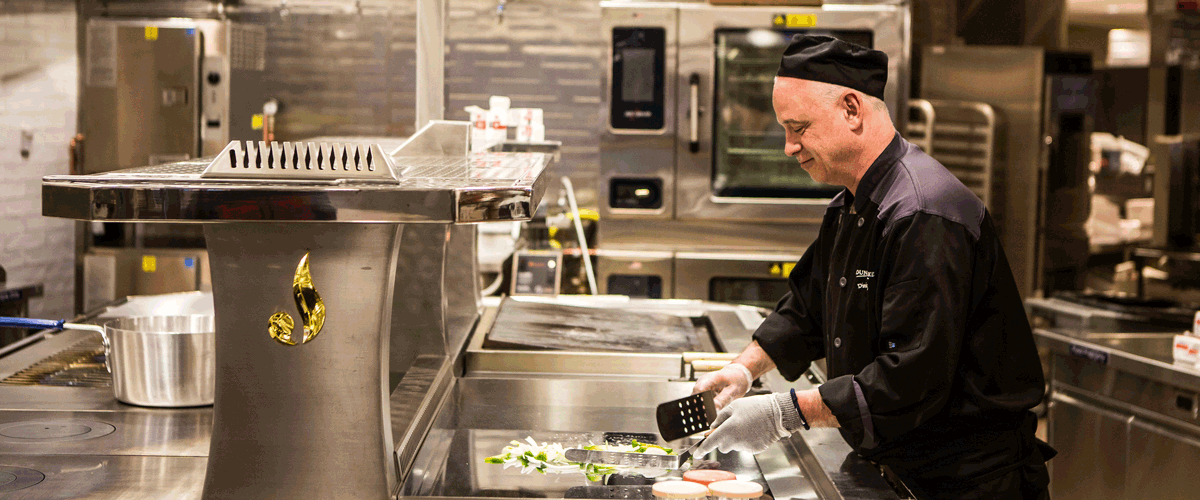 Photo of a Mount Holyoke College chef working in the kitchen