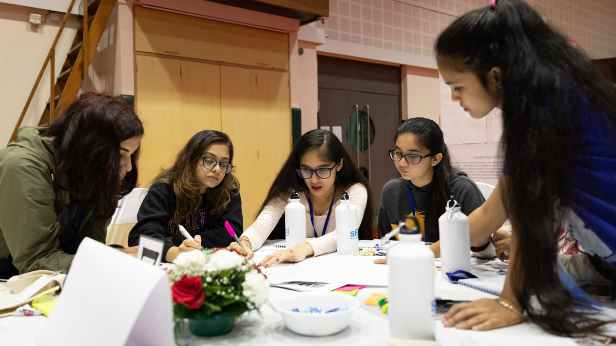 MHC Shakti participants working on a group project