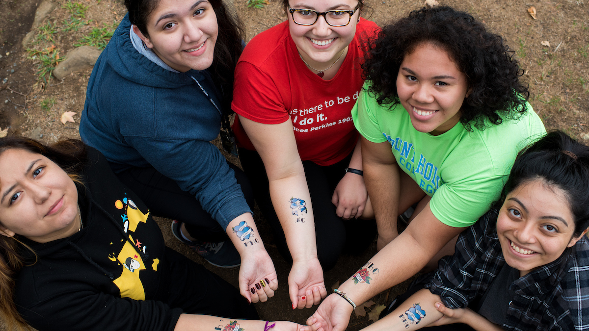 A group of students displaying their temporary tattoos on Mountain Day 2016