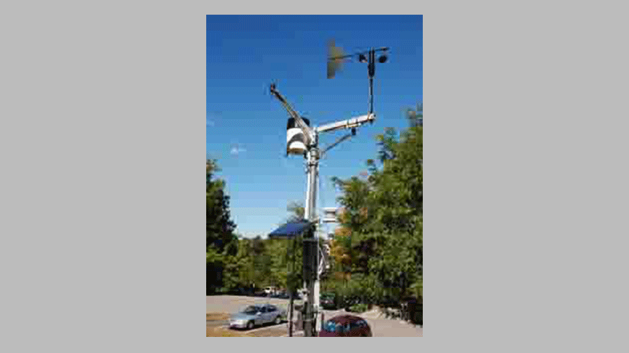 Photo of the HOBO weather station in the open site