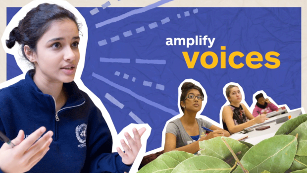 "Photo of a student speaking with the words ""amplify voices"" written"