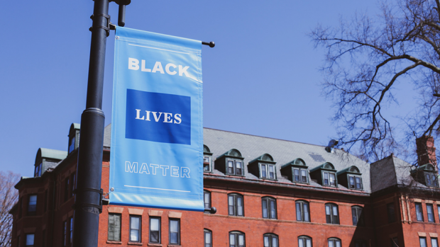 A black lives matter sign hanging on a lamp post on the Mount Holyoke campus