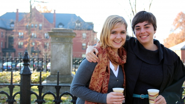 Photo of two students near Mary Lyon's grave