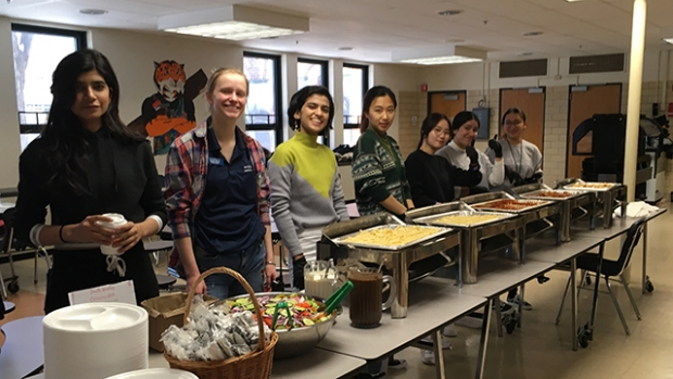 Mount Holyoke's newest students prepare to serve lunch at the Bag the Community food-pantry event.