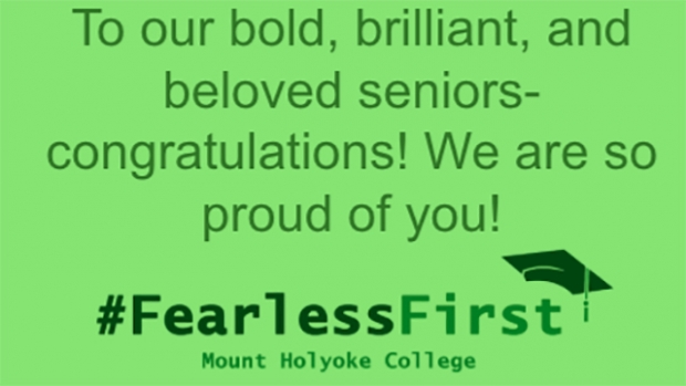 """This is an image of a digital slide from the cording ceremony that reads, """"To our bold, brilliant, and beloved seniors- congratulations! We are so proud of you! #FearlessFirst."""""""
