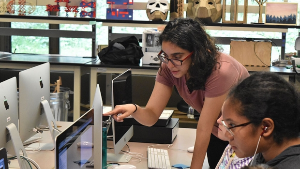 Galen Corey, instructor for the Girls Who Code campus program at Mount Holyoke, with eager students.