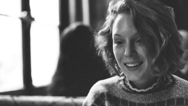 Black and white photo of Grace Ehlers '11 wearing a sweater.