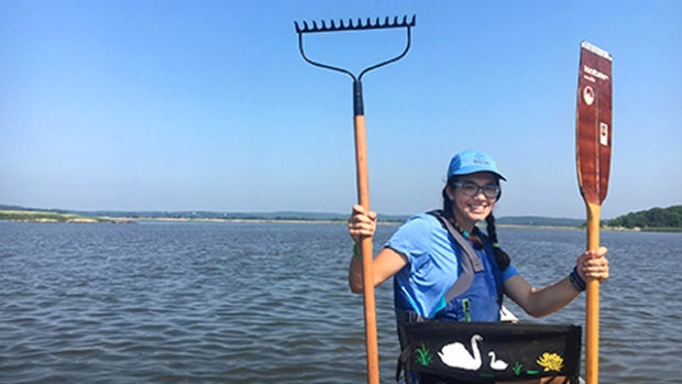 Photo of Halee Mahoney '20 in a canoe during her internship at the Roger Tory Peterson Estuary Center
