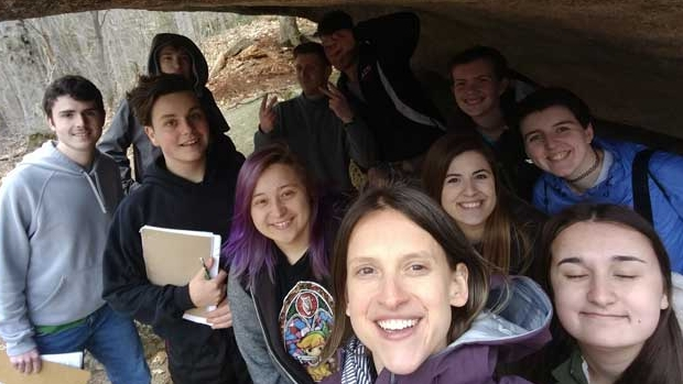 Katharine Hinkle '02 and her geology students underneath a glacial erratic in Franconia Notch, NH.