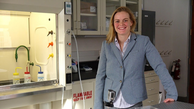Kerstin Nordstrom, Clare Boothe Luce Assistant Professor of Physics, smiling in her lab