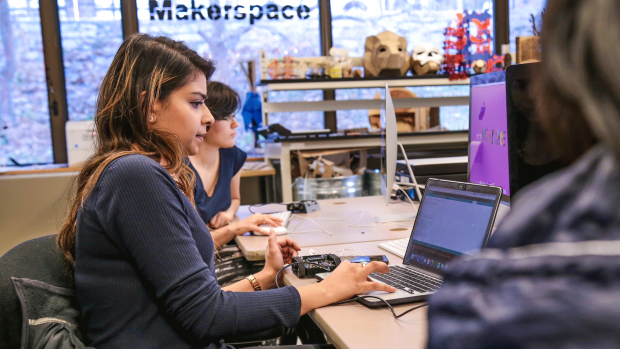 Photo of students working in the Makerspace