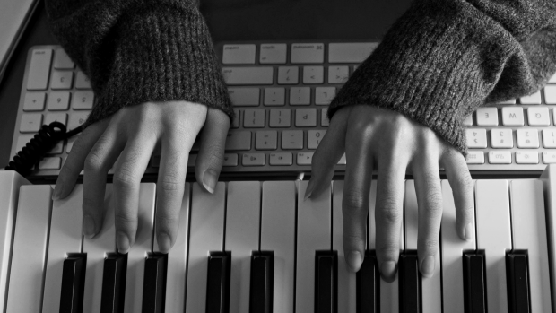 photo of hands placed across a laptop on a keyboard