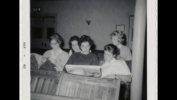Members of the Class of 1962 sitting in a Classroom