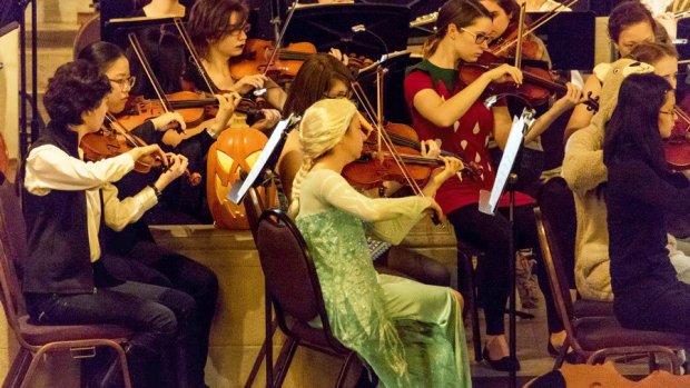 Photo of the Mount Holyoke Symphony Orchestra wearing costumes for the Monsters Ball concert