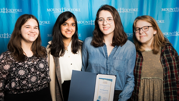 Members of the Mount Holyoke News editorial staff pose with their prize for excellence in programming.