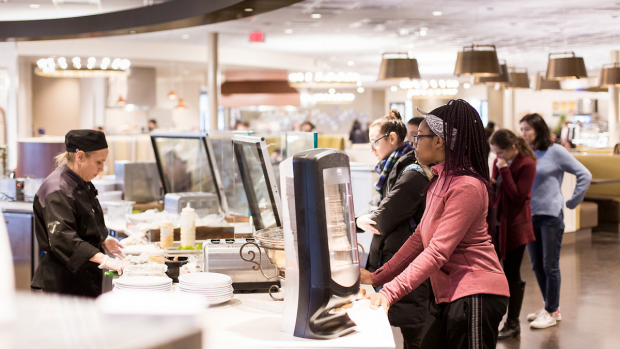 Students awaiting freshly prepared food in the Dining Commons