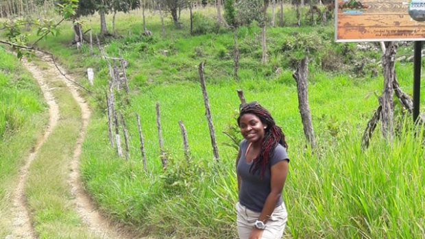 Photo of Neorgia Grant '20 standing along a path during her internship with the Southern Trelawny Environmental Agency in Jamaica