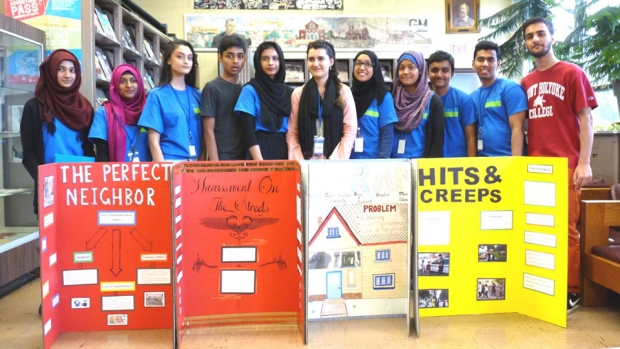 "This is a photograph of Iqbal with youth volunteers from her project in Hamtramck, Michigan, ""Be a Good Neighbor."""