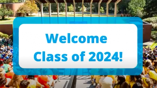 "This is a digital banner that reads, ""Welcome Class of 2024!"" It is overlaid on a photograph of a past convocation with students in bright colors gathered for the ceremony."