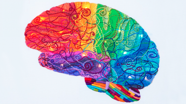 """This is """"Lit,"""" by Laura Bundesen. A colorful embroidered representation of the brain with LED lights."""