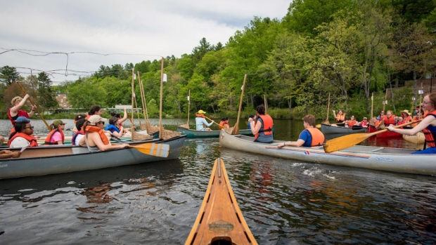 Photo of students rehearsing for the annual canoe sing