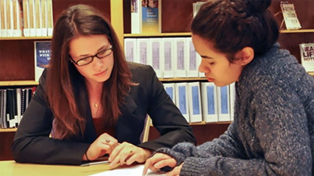Image of student with advisor.
