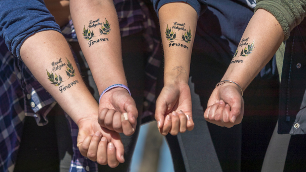 Mount Holyoke students showing off their temporary Mountain Day tattoos