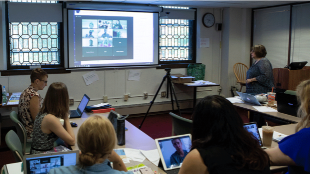 Photo of graduate students in a hybrid learning classroom