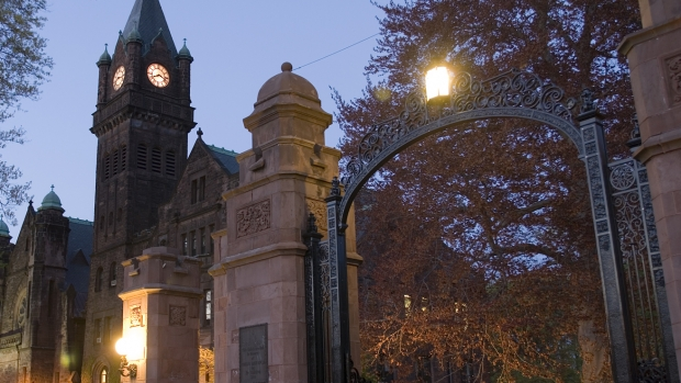 MHC's gate and tower at dusk.