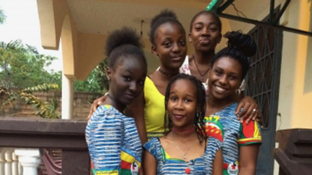 Photo of Olivia Lucas '18 and her host famliy in Cameroon
