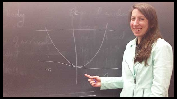 Liz  MacLauchlan drawing a parabola on the blackboard
