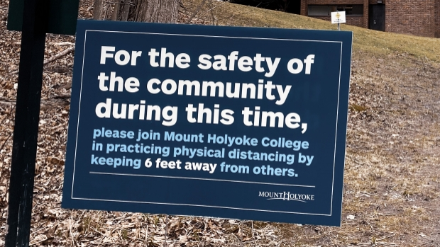 Sign of the times: Campus signs remind those who remain to practice physical distancing during the COVID-19 pandemic.