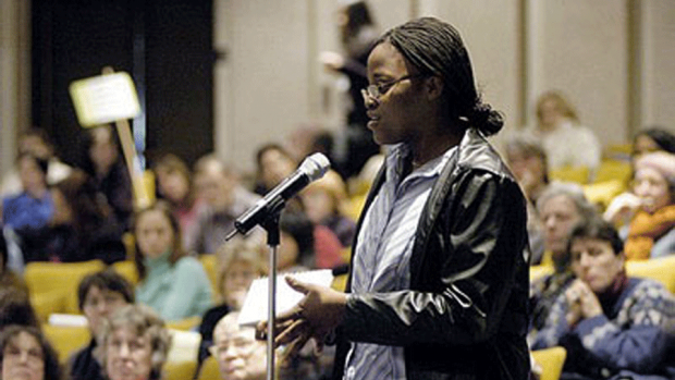 Photo of a student asking a question at the Offshore Outsourcing conference