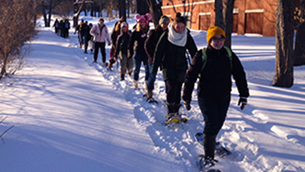 Photo of students snowshoeing on the Mount Holyoke College campus