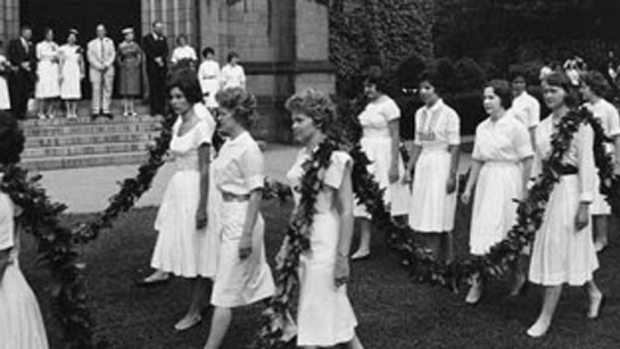 Archival image of students marching in the Laurel Parade