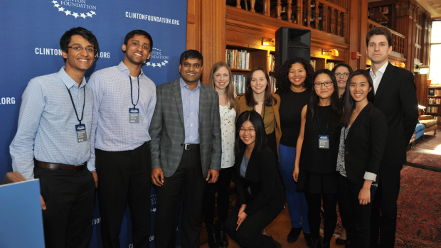 Photo of the winning code-a-thon team with Chelsea Clinton