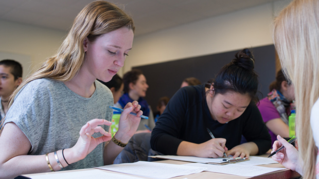Students writing during a course