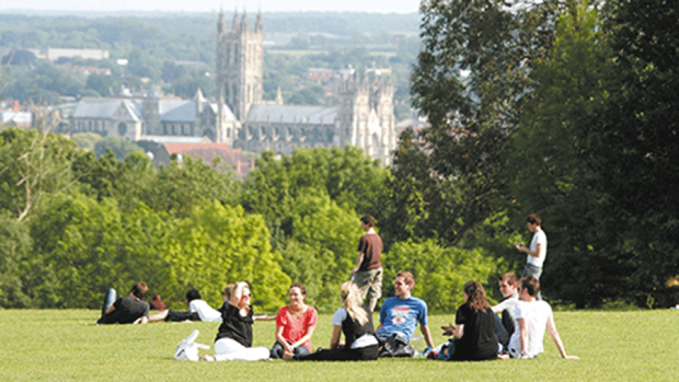 Photo of students on a hill overlooking the University of Kent