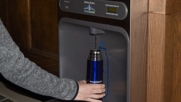 Photo of student using a water bottle filler