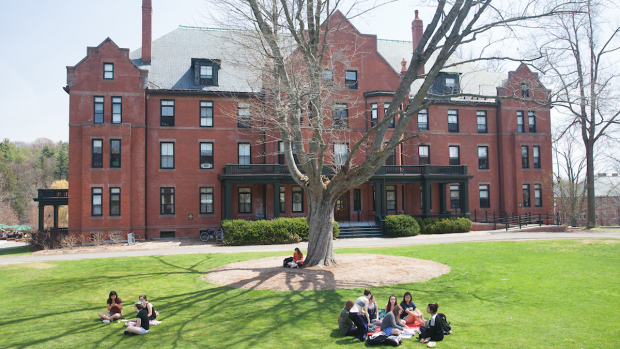 Students enjoying a beautiful day on Skinner Green in front of Wilder Hall, on of 18 residence halls