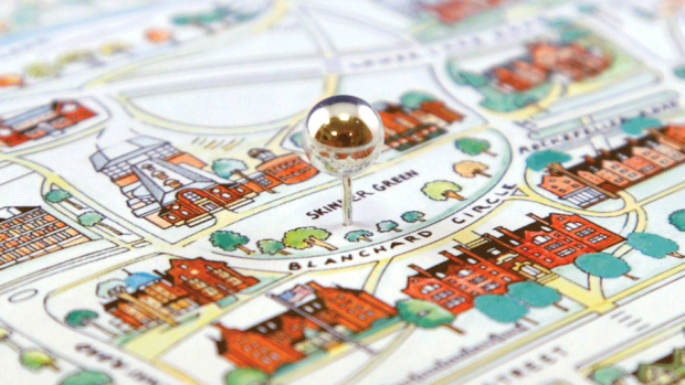 Photo of the campus map with a push pin inserted in the middle