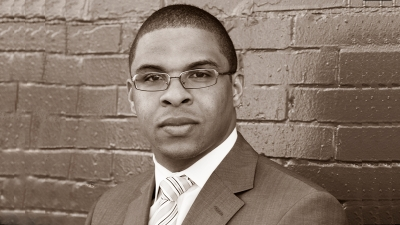 Roland Fryer, Professor of Economics, sepia photograph in front of brick wall