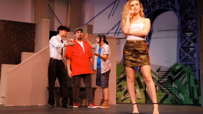 Actors on stage performing the play In the Heights