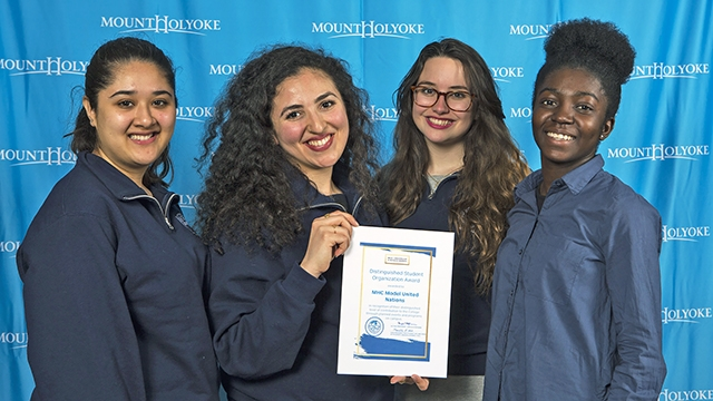 Board members of the Mount Holyoke Model United Nations pose with their Distinguished Student Organization Award citation (from left): Maham Khan '19, Marwa Mikati '17, Kim Foreiter '19 and Edith Amoafoa-Smart '19.