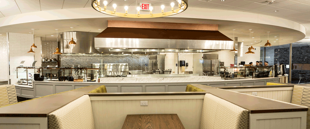 Photo of the inside of the dining commons booth seating and serving counter