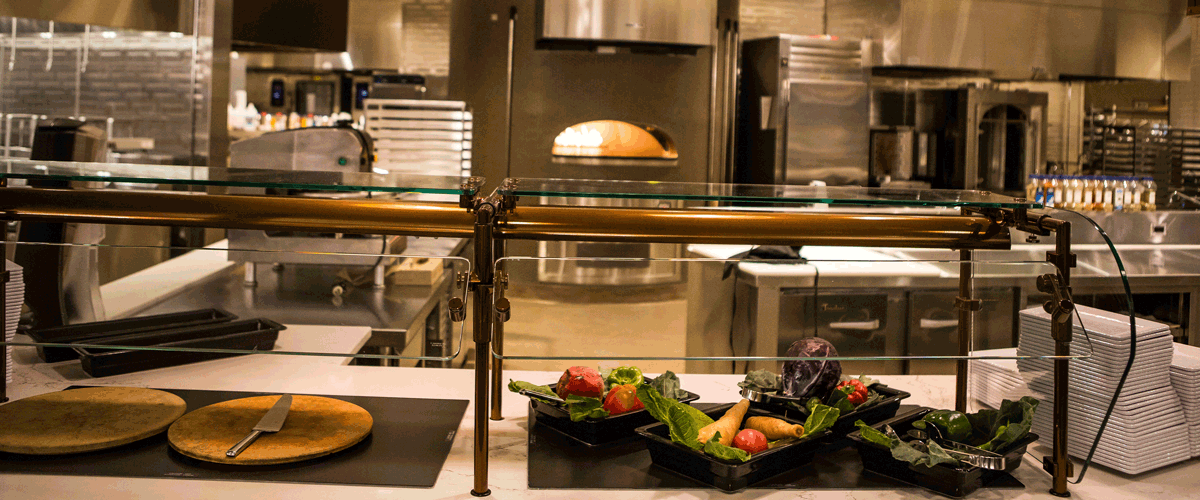 Photo of the inside of the dining commons brick oven and serving counter
