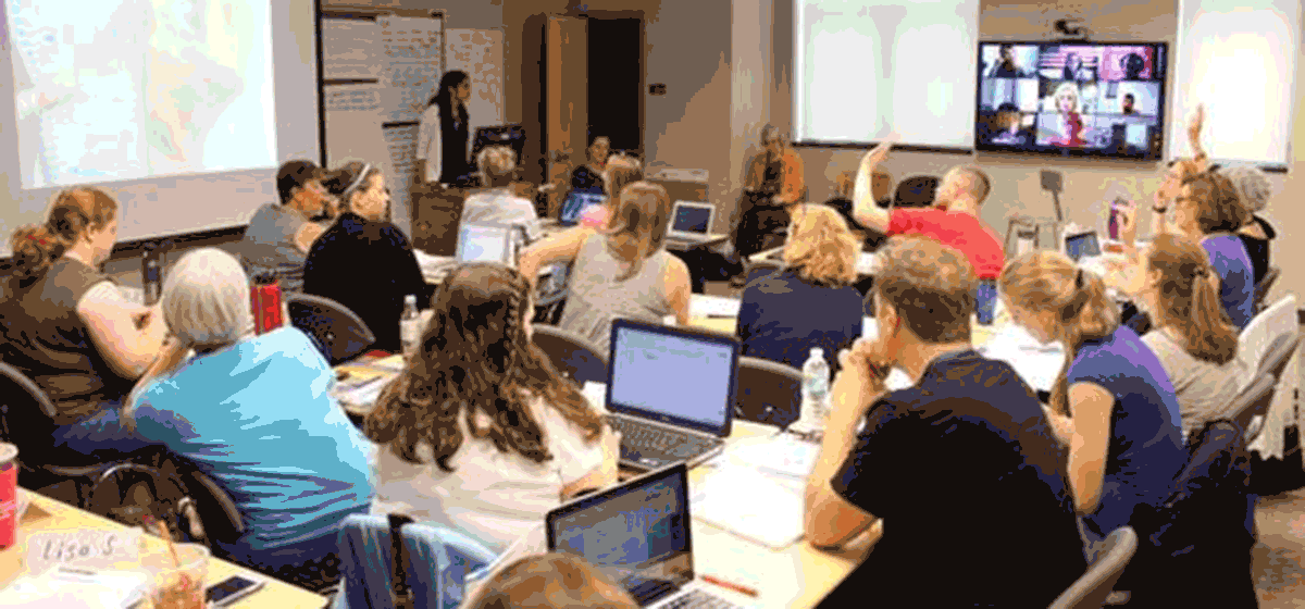 Photo of a classroom of graduate students
