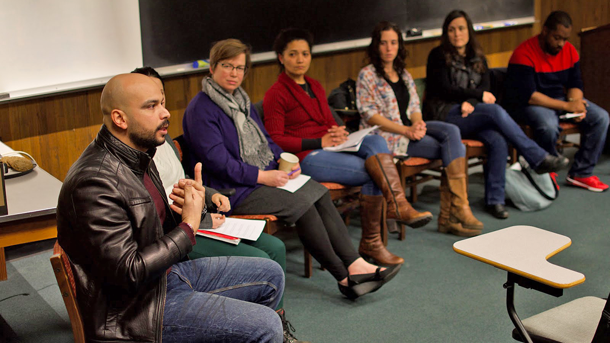 Photo of a panel of educators meeting with our ELL students to examine the importance of cultural awareness in K-12 schools.
